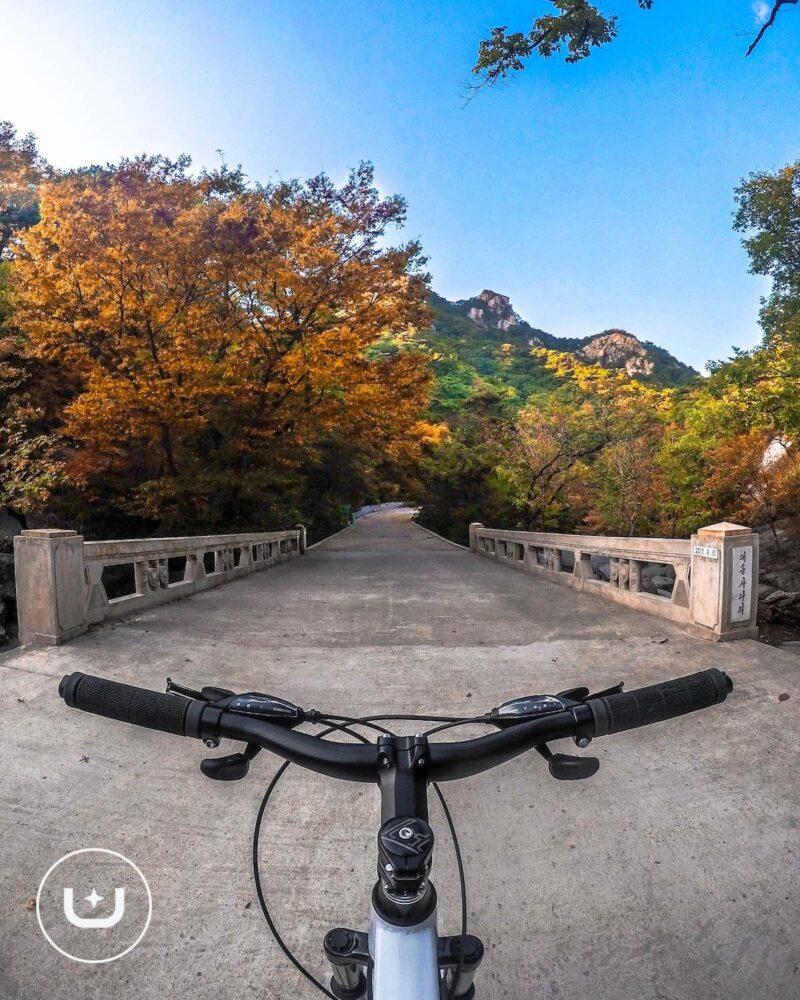 Mountain biking in North Korean nature.